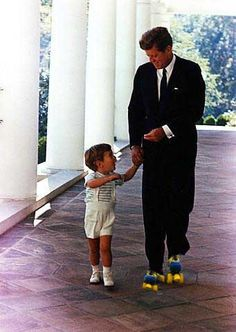John F. Kennedy roller skating at the White House!