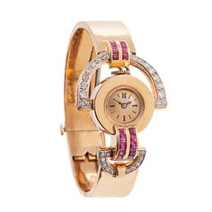 Lady's Gold, Diamond and Ruby Retro Bracelet Watch | From a unique collection of vintage wrist watches at http://www.1stdibs.com/jewelry/watches/wrist-watches/