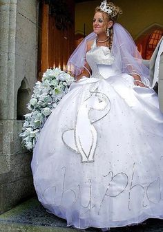The worst wedding dresses of all time – including nearly naked brides, black gowns and gigantic feathers Wedding Dress Fails, Funny Wedding Dresses, Weird Wedding Dress, Tacky Wedding, Funny Dresses, Western Wedding Dresses, Wedding Dresses Photos, Wedding Bridesmaid Dresses, Funny Outfits
