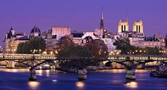View of the Ile de la Cite with the Pont des Arts in the foreground. The towers of Notre Dame are visible to the right. Paris At Night, France Photography, Popular Photography, Urban Landscape, Travel Photographer, Fine Art America, Cathedral, Instagram Images, River