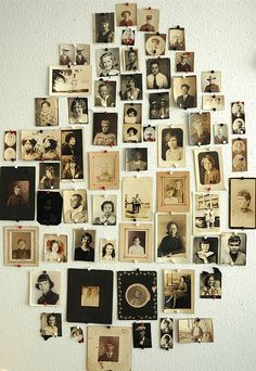Lisa Congdon's collection of vintage photo portraits displayed w/push pins on a wall (Bird in the Hand, via Flickr)