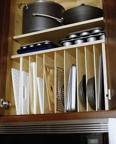 great way to organize pots and pans...i hate how my muffin pans and cookie…