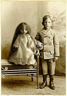 "Boy and his evil dolly ~ ""don't put me back in that box, you hear...or there'll be trouble!"" said scary doll, probably ;)"