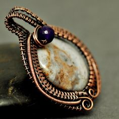 Nicole Hanna Jewelry | Wire Wrapped Blue Laced Agate, Copper Egg Pendant with Amethyst Accent | Online Store Powered by Storenvy