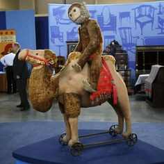 Large straw-stuffed camel pull-toy on cast-iron wheel set and early stuffed Jacko The Monkey toy, Germany, 1908, by Steiff. These toys were featured on the 4 August 2007 episode of American public broadcaster PBS's Antiques Roadshow program filmed in Spokane, Washington, and were appraised by antique toys and games specialist Noel Barnett at between $5,000-$6,500 for the pair.