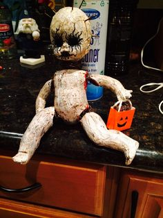 Halloween creepy doll  Starting with a baby doll begin by pulling all hair out and remove her limbs. Using Martha Stewart crackle paint. Start by painting her body  black. A must is using Martha's primer first before the crackle. Using a knife to apply crackle, work 1 limb at a time then immediately use a hair dryer to heat and dry. You'll see the paint start to crackle right away. Bigger cracks the thicker you apply the crackle paint, thinner cracks with less applied. After all parts are…