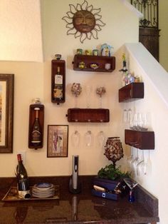 Repurposed sewing machine drawers for a wine glass display!