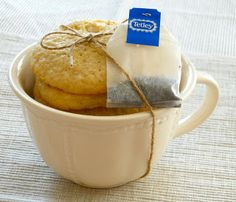 Gift cookies in a teacup with a friendly bag of tea attached with twine