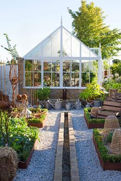 Stone foundation greenhouse with small garden beds and a nice collection of watering cans from Scandinavian Fancy Windows: Weekend inspiration. Orangery to relax Greenhouse Supplies, Greenhouse Shed, Greenhouse Gardening, Vegetable Gardening, Gardening Tips, Garden Buildings, Garden Structures, Landscape Design, Garden Design