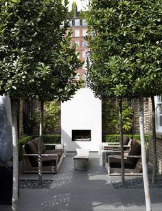 the ultimate outdoor living room in a London city garden, outdoor fireplace, table & seating surrounded by green, stone, & gravel Outdoor Areas, Outdoor Rooms, Outdoor Living, Outdoor Sitting Areas, Outdoor Patios, Modern Landscaping, Backyard Landscaping, Backyard Seating, Backyard Ideas