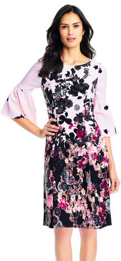 Adrianna Papell | Floral Bliss A-Line Dress with Three Quarter Bell Sleeves | Romantic florals drift down this lovely dress. This A-Line dress features a boat neckline, three quarter sleeves with bell flares, and a mixed floral print. Crafted from crepe fabric, this dress is comfortable for all day wear whether headed to work or to an event. A strappy heel and clutch will elevate this floral dress.