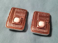 Check out this item in my Etsy shop https://www.etsy.com/listing/482744175/laurel-burch-vintage-aztec-clip-earrings