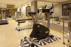 Gimnasio / Gym AC Hotel Malaga Palacio by Marriott