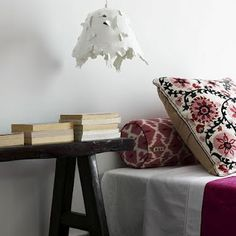 This feminine bedroom is mature, exotic, and eclectic. Mixing rough hewn elements like the bedside table with traditionally patterned textiles, it's a pretty and refreshing space. Feminine Bedroom, Mauve Bedroom, Bohemian Interior Design, Modern Interior, Wooden Side Table, Pink Pillows, Scandinavian Bedroom, Ideal Home, Boho