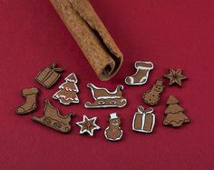 A kit of 36 dollhouse miniature cookies (2 cookies of 18 designs: gingerbread boy, gingerbread girl, heart, star, mitten, house, sleigh, tree, snowman, 2 different snowflakes, present, stocking, bell, pine cone, wreath, candy cane, ornament). No molds or polymer clay needed. Precut thick paper with laser engraved lines.