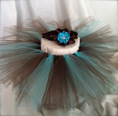 Aqua and Brown tutu $18. Matching hair clip $5 (with headband $7).This tutu can be made into any size from newborn up to adult sizes! Both items are handmade by Tutu Cute N Sweet where you can find the store on www.etsy.com/..., Facebook, and shopinterest.co