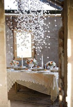 "Winter Wedding Ideas using hanging centerpieces to add the ""look"" of snow to the wedding decorations."