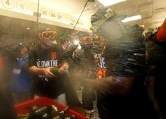 San Francisco Giants' Hunter Strickland (60) celebrates their 6-3 win in the clubhouse against the St. Louis Cardinals in Game 5 to win the National League baseball championship series in San Francisco, Calif., on Thursday, Oct. 16, 2014.  (Nhat V. Meyer/Bay Area News Group)