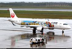 J-Air (JP) Embraer ERJ-190STD (ERJ 190-100) JA248J aircraft, in current ''Tsurumaru-Crane circle'' livery, painted in ''Universal Studios Japan (JAL Minion Jet)'' special colors Jul. 2017, rolling on the wet runway, at Japan, Niigata second class Airport. 10/10/2017.