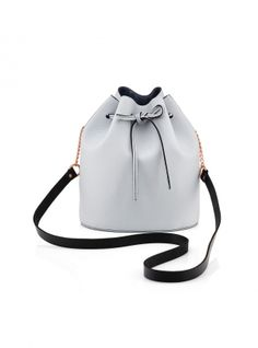 Young+British+Designers:+Small+Drawstring+Bucket+Bag+in+Pale+Grey+by+Baia+Bags+-+See,+we+love+the+details+on+this+perfectly+sized+bucket+bag.+Its+full+grainy+leather+feel,+its+drawstring+with+contrast+navy+edging+and+the+peep+of+plush+navy+suede+inside.+Did+we+mention+the+rose+gold+chain+too?+