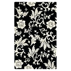 Stylishly anchor your living room or master suite with this alluring hand-tufted New Zealand wool rug, showcasing an eye-catching floral motif in black and i...