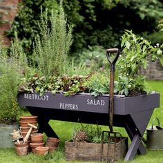 Cute idea for easy raised herb garden, plus this site has 25 more ideas for cute container vintage style gardening.