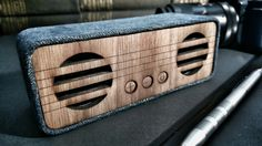 Hand made portable Bluetooth speaker. Laser cut hard wood and denim. First picture of my new speaker... It will be available on Etsy soon. I will add a link.