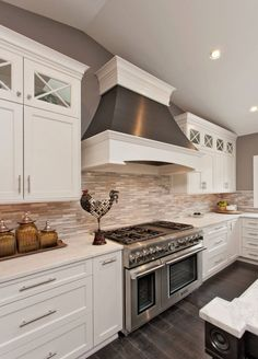 White Kitchen Cabinets for Your Cozy Kitchen: White Kitchen Cabinets With Marble Subway Tile And Oversized Range Hood Also Dark Wood Floor And Rooster Plus Ceiling Lighting ~ flexform.org Furniture Inspiration
