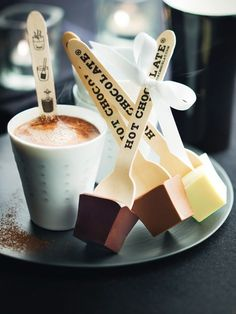 Hot chocolate on a stick: cubes of chocolate fudge that get dissolved in hot milk to make creamy goodness.