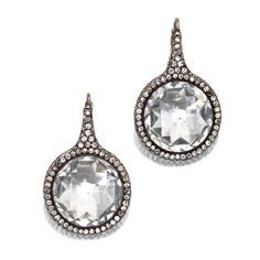 PAIR OF ROCK CRYSTAL AND DIAMOND EARRINGS, TAFFIN  |  Designed as pendants set with faceted rock crystal segments, framed by single-cut diamonds weighing approximately 3.00 carats, mounted in gold and silver, signed Taffin, numbered TF627.