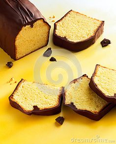 Photo about Lemon cake with chocolate coating on yellow ground. Image of glaze, sweets, vertical - 27162430 Cake Stock, Chocolate Coating, Lemon, Sweets, Inspirational, Bread, Stock Photos, Baking, Food