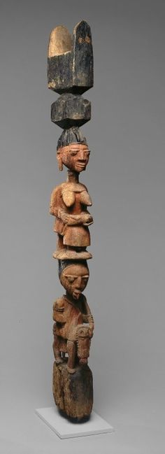 Africa   Yoruba House Post.  (1 of a pair) Nigeria.  Wood and pigment.  ca. 19th or early 20th century   Figurative posts often support the verandas of distinguished places such as important shrines or the dwellings of kings, titled elders, and priests. Just as a post supports the house, the carved figures represent the individuals who support and uphold the leader in his office