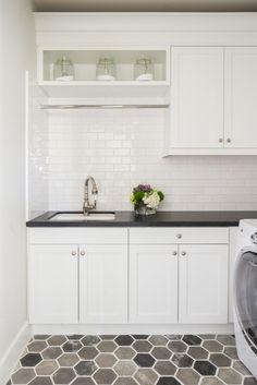 Hexagon floor tile truly pops against these fresh white cabinets + white subway tile backsplash | Designworks