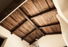 This ceiling used hand hewn Douglas fir beams with semi surfaced Douglas fir planking. The beams have a dark brown wax applied. Products Used: Hand Hewn Douglas Fir Beams, Semi-Surfaced Douglas Fir Plank