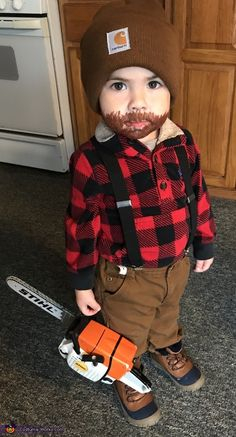 This is my 3 year old son Lucas the mini lumberjack. I came up with the idea because he has this toy chainsaw (in picture) that he absolutely loves. His dad does tree work so I figured it was perfect. Made from clothes he already. Lumberjack Halloween, Baby Girl Halloween Costumes, Halloween Costume Contest, Halloween Kids, Costume Ideas, Infant Halloween, Halloween Makeup, Halloween Stuff, Lumberjack Costume