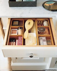 "Drawer Dividers ""Bathroom drawers are second only to junk drawers in their potential for messiness. It's too easy to toss grooming products in there pell-mell. Wooden boxes and trays help categorize the items and are available in various sizes and materials, so they can be mixed and matched to fit any sort of drawer."" Martha Stewart"