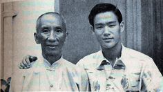 A young Bruce Lee posing for a picture with Grandmaster Ip Man.