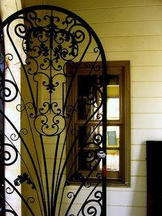 I want this iron gate in my kitchen going to my pantry!