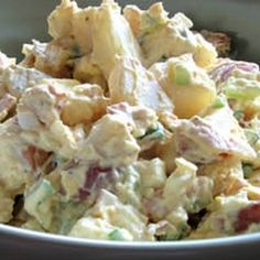 2 pounds red potatoes  6 eggs  1 pound bacon  2 scallions, finely chopped  1 stalk celery, finely chopped  1 cup shredded cheddar cheese  1 cup Miracle Whip  1 cup sour cream  salt and pepper to taste  Chop the cooled potatoes, leaving skin on. Add to a large bowl, along with the eggs, bacon, onion and celery. Add mayonnaise, salt and pepper to taste. Chill for an hour before serving.