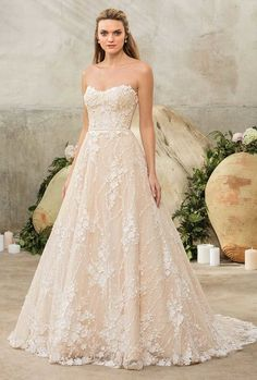 Casablanca Bridal Style 2288 Sienna Strapless ballgown with modified sweetheart neckline and chapel train made from sequined floral lace and satin.    View Website</div...