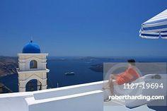 Relaxing woman in a Hotel in Imerovigli, Santorini, Cyclades, Greece MR