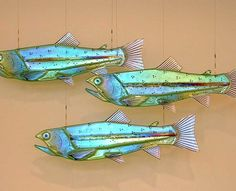 Mark Ditzler's signature fused glass fish are perfect for public art displays and interior design.