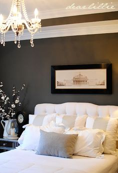 Love the dark walls with the white bedding...Beautiful bedroom from Dear Lillie