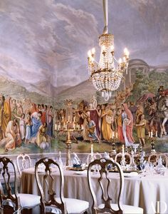 The dining room. The fresco, by Luigi Ademollo, depicts Aeneas leaving Troy. Marchesa Pucci and her husband added the Venetian chairs. The crystal glassware was made for the family in the century. Interior Exterior, Interior Design, Modern Exterior, Elegant Dining Room, Crystal Glassware, Italian Villa, Home Photo, Architectural Digest, Inspired Homes