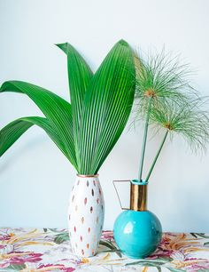 """""""I like to freshen things up when springtime rolls around with big statement leaves in fun vases. From banana leaves and philodendron leaves, to palms and papyrus, it's an easy and low-maintenance way to add a freshness to a room without any fuss. And if you regularly refresh the water and trim the bottom of the stem, the leaves can live on for months."""" —Justina Blakeney   - ELLEDecor.com"""
