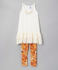 Love this Ivory Double-Ruffle Top & Orange Floral Leggings - Kids & Tween on #zulily! #zulilyfinds