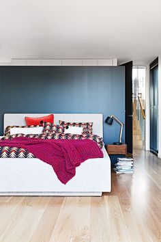 Master bedroom Kip & Co bedlinen and bright Ikea rug, add a pop of fun colour.