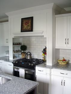 Love the cabinets around the stove with the spice shelves built in