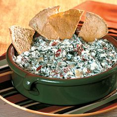 Info: This slow-cooker spinach-artichoke dip is so rich and satisfying, you won't even know that it's low in fat and calories, too! #appetizers