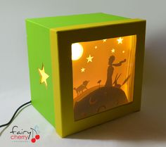 This is a Lttle Prince theme lighted shadow box, made with paper cut, inspired by Hari & Deepti artwork! From the famous book of Antoine de